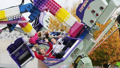 Children enjoy carnival rides at the 2012 Fall Festival of Leaves.