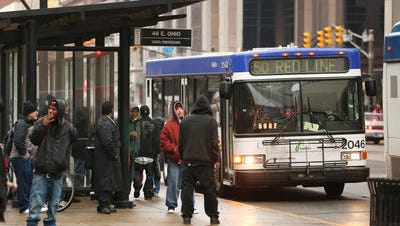 Passengers wait for IndyGo buses Downtown.