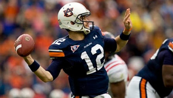 Auburn quarterback Chris Todd throws pass against Ole