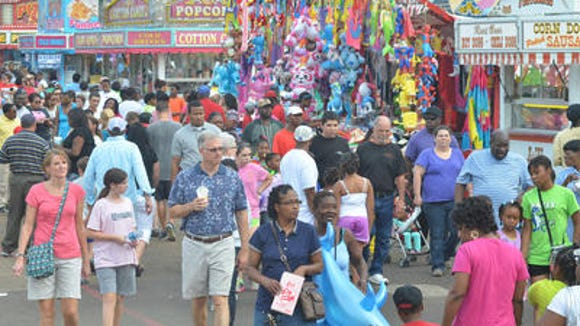 Fairgoers at Mississippi State Fair enjoy pleasant temperatures, food, and attractions on the Mississippi Fairgrounds in Jackson.