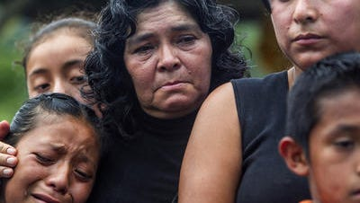 Family members of Nelson Omar Chilel Lopez, 13, gather at his funeral in Guatemala. His remains were found in the desert three years after he crossed the border.