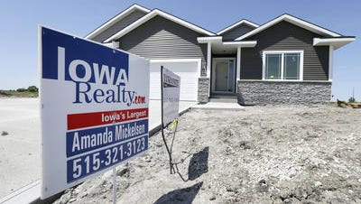 In this May 21, 2014 photo, a sign sits in front of a new home for sale in West Des Moines, Iowa. Sales of U.S. new homes recovered in April after slumping in the previous two months. But Americans are still buying new homes at a slower pace than they did a year ago.