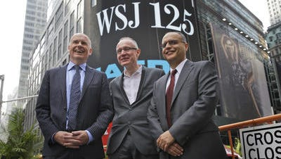 Gerard Baker, Editor in Chief of The Wall Street Journal, left, Robert Thomson, CEO of News Corp, center, and Bedi Singh, CFO of News Corp, participate in the opening ceremonies at the Nasdaq MarketSite in New York, Tuesday, July 8, 2014. News Corp opened the Nasdaq to celebrate the 125th anniversary of The Wall Street Journal. U.S. stocks are slipping in early morning trading Tuesday as investors await a string of corporate earnings reports this week.