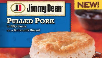 This photo provided by Hillshire Brands shows the packaging for a Jimmy Dean Pulled Pork sandwich. Jimmy Dean, the breakfast sausage brand started by the late country singer of the same name, is hoping its new bowls and sandwiches can lure eaters at other meals.