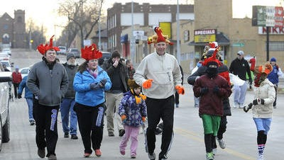 Runners and walkers take part in last year's Run for Food for The Banquet in Sioux Falls, S.D., Thursday, Nov. 28, 2013.