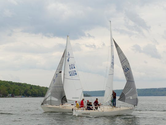 Boats maneuver for a good position at the start of a May race organized by the Cruising Fleet at the Ithaca Yacht Club on Cayuga Lake. From left, Eberhard Alsen's Tanzer 25, Fantasy; David Feavearyear's J24, Snitch; and Clare Festrell's J24, Mehitabel.