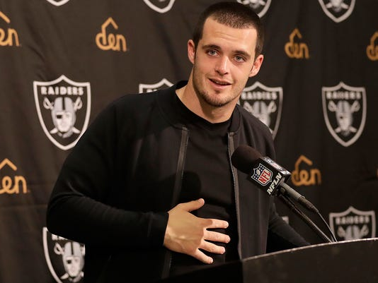 FILE - In this Nov. 27, 2016, file photo, Oakland Raiders quarterback Derek Carr speaks at a news conference after an NFL football game against the Carolina Panthers, in Oakland, Calif. Raiders quarterback Derek Carr has finalized a five-year contract extension that will keep him tied to the team through the 2022 season. Carr tweeted Thursday, June 22, 2017, that an agreement had been reached to add five years to his current rookie deal that expires after this season. The contract will be worth $125 million, according to a person familiar with the deal who spoke on condition of anonymity because terms were not released. (AP Photo/Marcio Jose Sanchez, File)