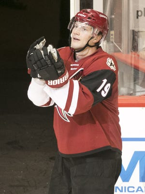 The Coyotes' Shane Doan greets the crowd in what was his 1500th game and when he scored his 400th goal just after the NHL game against the Maple Leafs at Gila River Arena in Glendale on Friday, December 23, 2016. The Maple Leafs won the game 4-1.