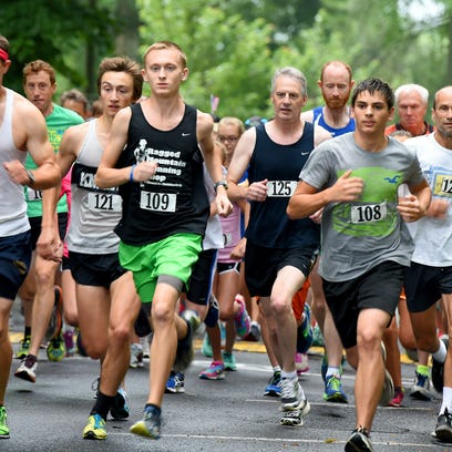 Runners leave the starting line during the Firecracker