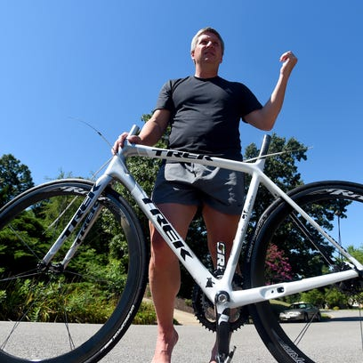 Herb Rathmell of Fishersville holds up the bicycle