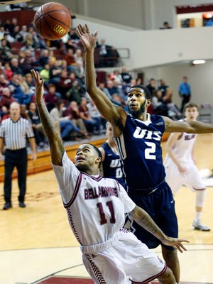 Bellarmine's Michael Parrish drives past Illinois Springfield's Davi Austin to grab two. 
