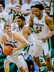 MSU's Kyle Ahrens, left, snarls as he secures a rebound