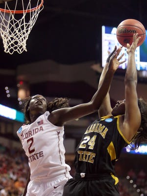 Alabama State forward Britney Wright is fouled by Florida State center Adut Bulgak as she attempts a shot during the first half of a women's college basketball game in the first round of the NCAA tournament in Tallahassee, Fla., Saturday March 21, 2015. (AP Photo/Steve Cannon)
