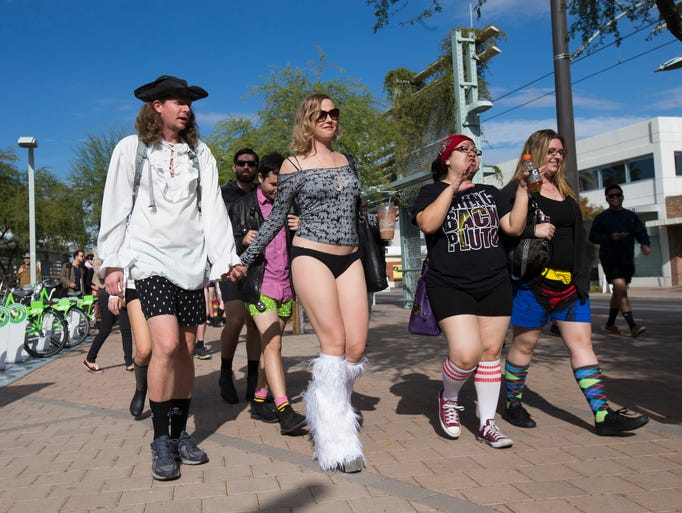 Pantless light rail riders get off the train in Phoenix