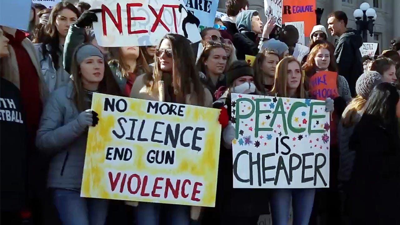 Students from Marshall County High joined the gathering on the steps of the Capitol building in Frankfort to protest gun violence one month after the Parkland, Florida high school shooting.