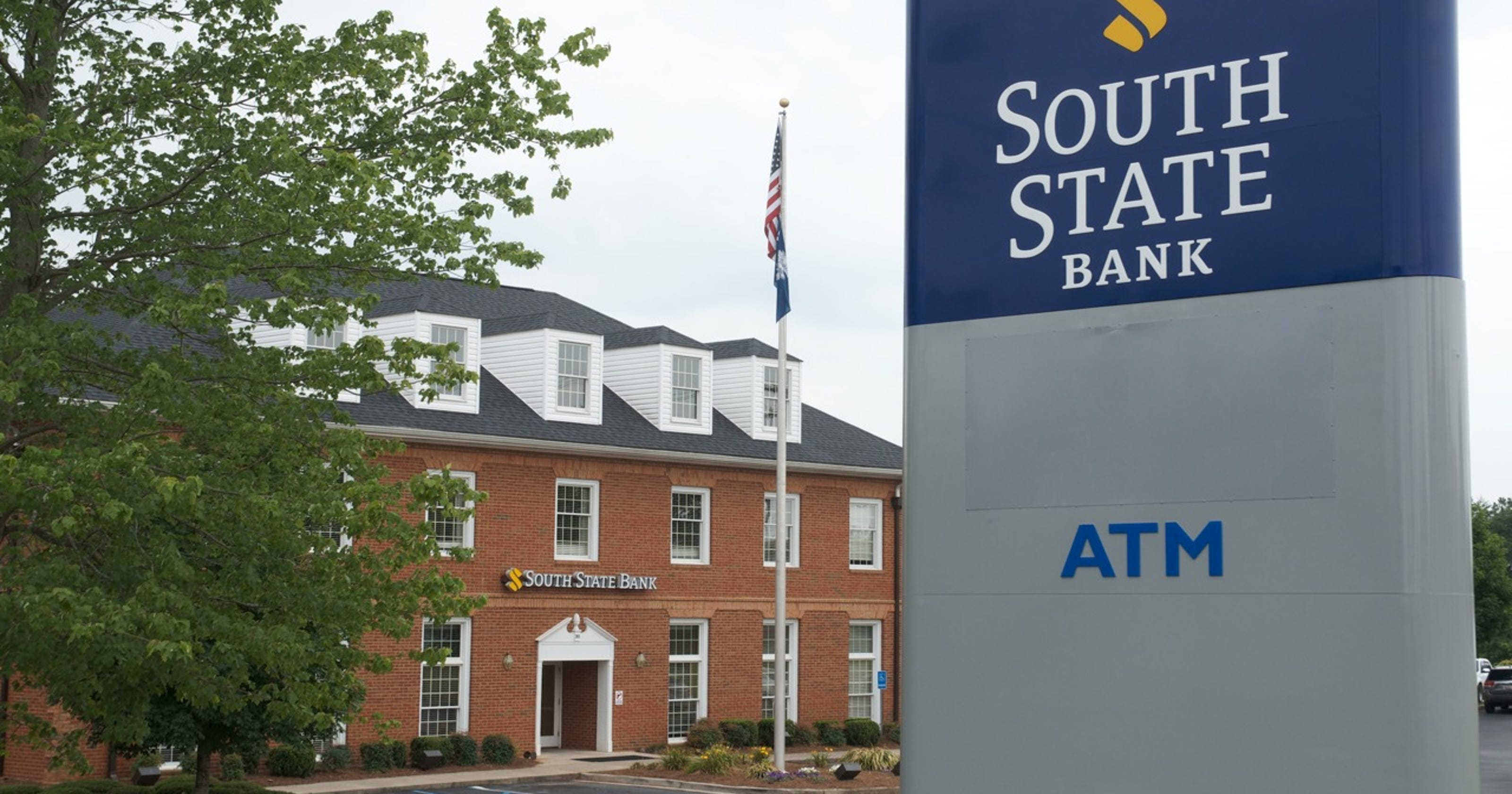 Bank unveils new signage to reflect name change