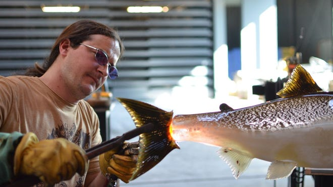 Artist Raven Skyriver works in Amphitheater Hot Shop at the Corning Glass Museum.