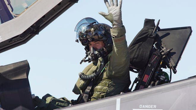 030720140253pg-PNI F-35 arrives at Luke Air Force Base-3-10-2014-U.S. Air Force Col. Roderick Cregier signals after opening the cockpit in his F-35 , after landing at Luke Air Force Base in Glendale, Arizona, Monday, March 10th, 2014.  The aircraft is the first of 144 F-35's that will be based at Luke, signaling the beginning of a new mission at the base, to train fighter pilots in the F-35 for the next few decades to come.   Photo by Tom Tingle/The Arizona Republic