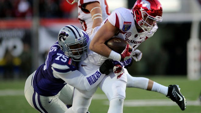 The Bengals took Kansas State Wildcats defensive end Jordan Willis, left, in the third round of the 2017 NFL Draft.