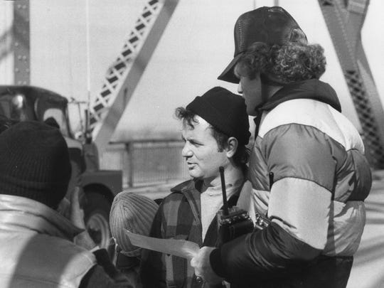 Bill Murray, cetner right, waiting for the start of a scene shooting The Clark Memorial Bridge in November 1980.