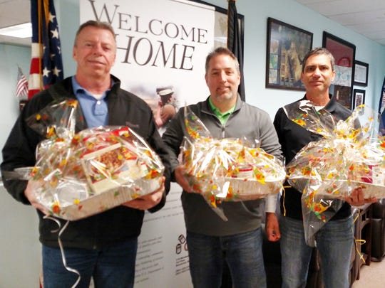 Nov. 22, 2015 Basket Brigage over 275 Thanksgiving baskets were created to give to the needy by the Meadowlands Chamber.  Gary Wunderlich, Jason Sawyer And Anthony Guzzo drop off baskets at the Secaucus Veterans Center.  Staff photo by Meghan Grant  --  SOUTH BERGENITE