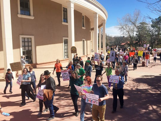 """A rally in support of greater state funding for public education in New Mexico drew hundreds of teachers, parents and students to the state Capitol in Santa Fe, N.M., Thursday, March 16, 2017. Sign-waving protesters paced around the circular state Capitol building to chants of """"no more cuts"""" and """"save our schools."""" Santa Fe Public Schools Superintendent and former state education secretary Veronica Garcia canceled classes at mid-day so that staff and students could urge lawmakers and the governor to bolster spending on K-12 schools for the coming school year."""