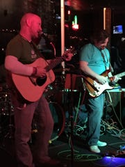 Jim Streisel and Donny Coyle play with The Dead Squirrels at Kip's Pub on Jan. 10 in Indianapolis.