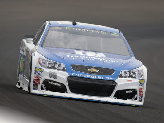 Race driver driver Dale Earnhardt Jr. (88) drives through the first turn during practice for the NASCAR auto race at Indianapolis Motor Speedway, in Indianapolis Saturday, July 22, 2017. (AP Photo/Michael Conroy)