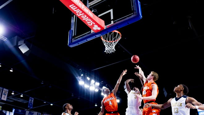 Powell's Desmond Billingsley (4), Whitehaven's Alvin Miles (3) and Powell's Westin Reynolds (40) reach for the rebound during a Division I Class AAA quarterfinals game between Powell and Whitehaven at the TSSAA boys state basketball championships at the Murphy Center in Murfreesboro, Tennessee on Wednesday, March 14, 2018.