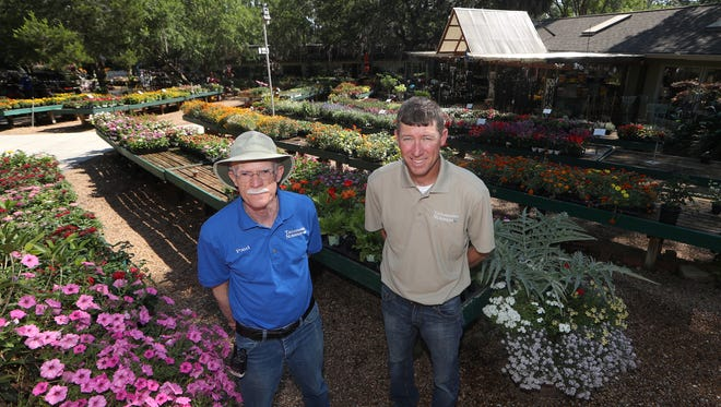 Co-owners Paul Brock, left, and Nate Prosser at Tallahassee Nurseries, which opened in 1938, is celebrating its 80th anniversary this year.
