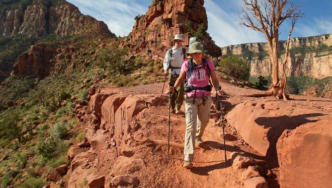 Sylvia Kadlubowski and Keanu Dirks descend along South Kaibab Trail at Grand Canyon National Park April, 24, 2013 in Ariz. .