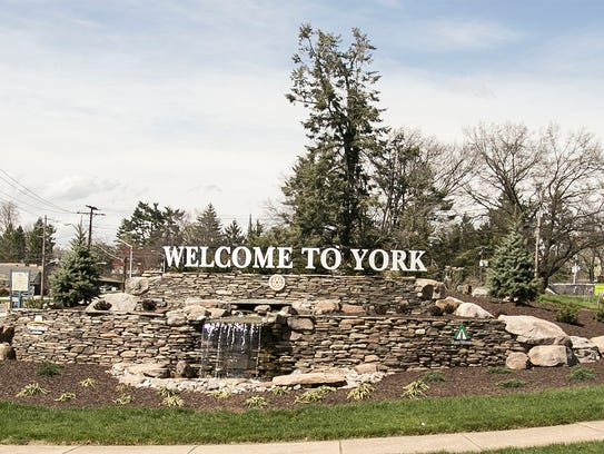 """A Pinwheel Garden surrounds the """"Welcome to York"""" sign"""
