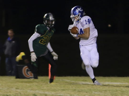 Macon County's Braxton Crawford makes reception and