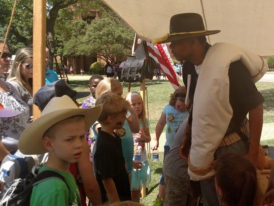 Dressed as a post Civil War-era soldier, Allen Mack