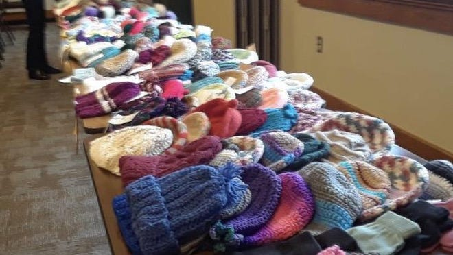 Tables of handmade hats, mittens and scarves made by local craft clubs and volunteers at the Children's Enrichment Committee of Orange County, helped  spread warmth to local foster children this winter.