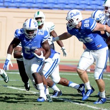 Duke Blue Devils Joseph Ajeigbe (23) recovers a fumble and runs for a touchdown during the second half against the Tulane Green Wave at Wallace Wade Stadium.
