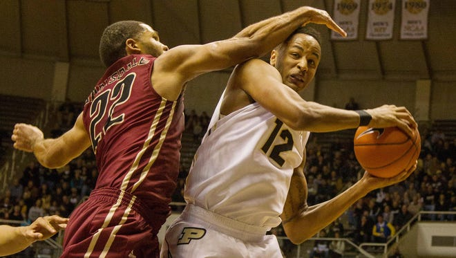 IUPUI Jaguars guard Marcellus Barksdale (22) fouls Purdue Boilermakers forward Vince Edwards (12) in the second half of the game at Mackey Arena. Purdue Boilermakers beat the IUPUI Jaguars 77-57.
