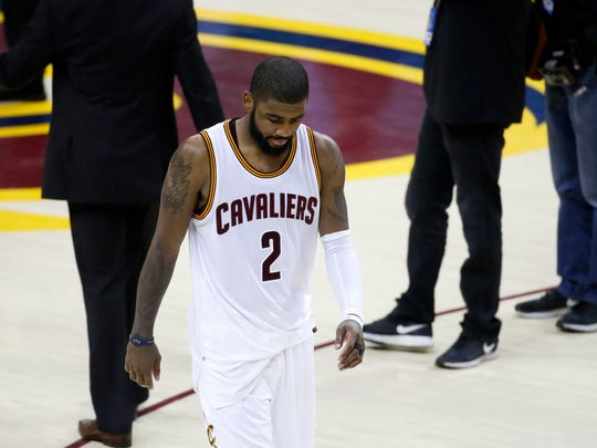 Cleveland Cavaliers guard Kyrie Irving (2) walks off the court after the Cavaliers lost to the Golden State Warriors 118-113 in Game 3 of basketball's NBA Finals in Cleveland, Wednesday, June 7, 2017. (AP Photo/Ron Schwane)