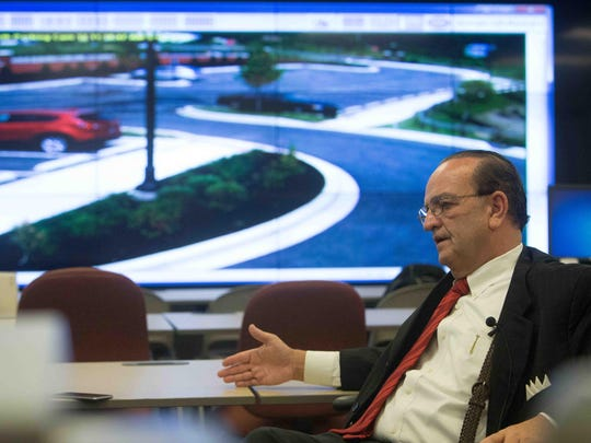 New Castle County Executive Tom Gordon discusses his perception of the ISIS threat in Delaware and the county's new surveillance cameras as he sits in front of a screen at the county's J. William Bell Fusion Center.