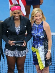 Chris Evert, with world No. 1 Serena Williams, runs