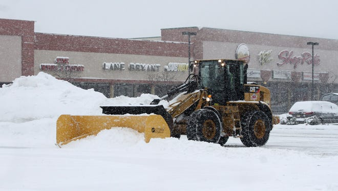 Even though the Blizzard of 2015 did not live up to the hype, people of Middlesex County needed to clean up at least 3-5 inches of snow though out the county  Heavy machines move snow from the parking lot of the Midstate Mall in East Brunswick. . On Tuesday  January 27  ,2015Photo: Mark R. Sullivan/Staff Photographer