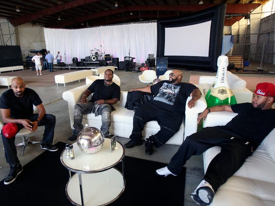 Members of Linkin' Bridge relax before performing at the JillÕs Wish Derby Cocktail Party Saturday night.  From left to right are Ekoe Alexanda, Big Rome Kimbrough, Montre Davis and Shon China Lacy.