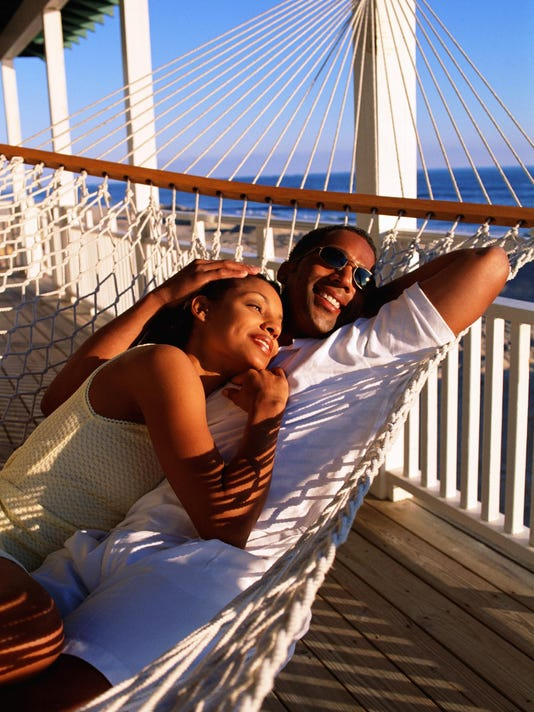 Couple in hammock on porch