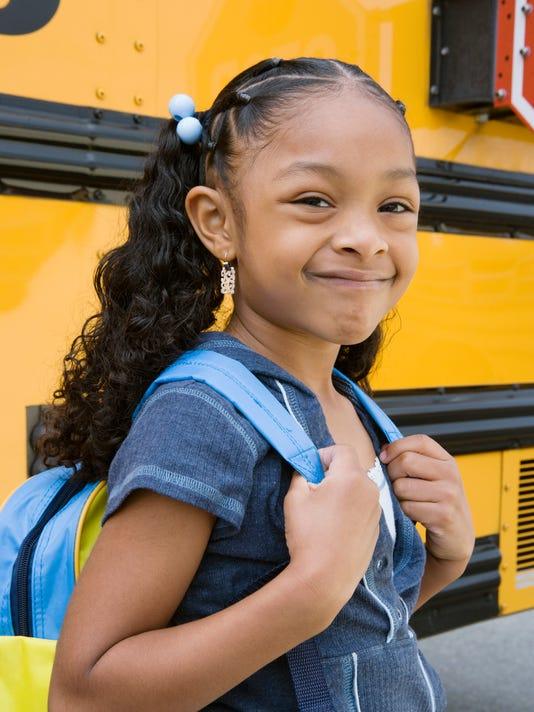 School Girl by School Bus