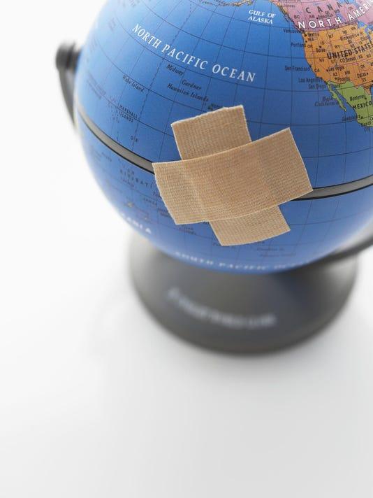 Globe with Adhesive Bandage