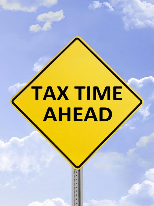 Tax Time Ahead Yellow Road Sign