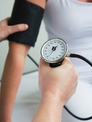 Adults 18 and over should have their blood pressure checked. It should happen at every doctor's visit, or if you're concerned, there are blood pressure machines at many local grocery stores.