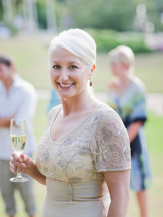 Mature woman drinking champagne