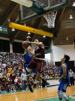 Kyle Gaitan of the Friars goes for the basket during the IIAAG championship game between the St. Paul Warriors and Father Duenas Friars held at the UOG Calvo Field House on Mar. 10.