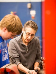 Instructor Andrew Sansone works with a student during a class at Burlington Technical Center, which offers a variety of courses for adults.